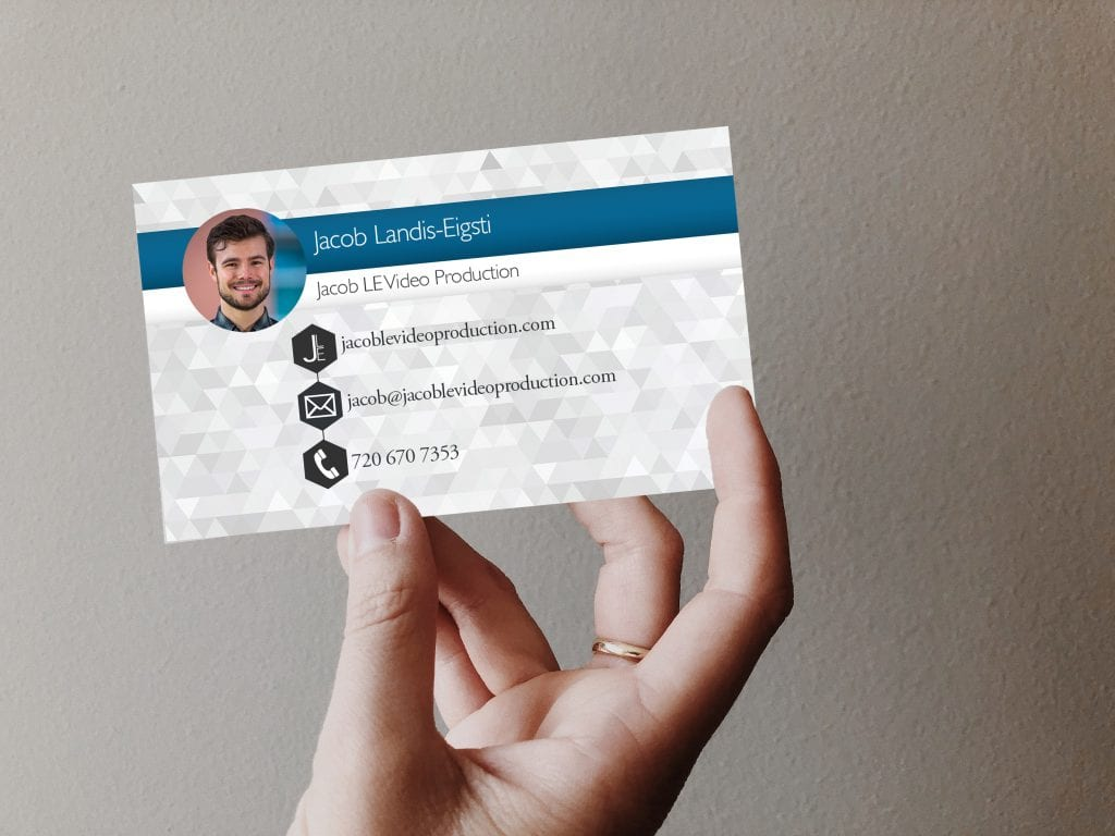 networking holding a business card then looking online